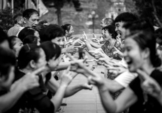Black and White photo by Graeme Heckels Hanoi Street Photography Laughing Yoga