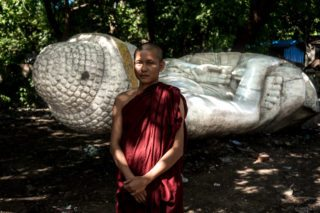 Monk by Fallen Bhuddha by Graeme Heckels_Mandalay Street and Travel Photography